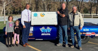 people holding large check