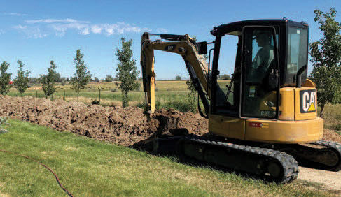 CAT tractor digging in ground
