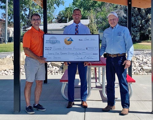 Better Billings foundation holding large check from svec