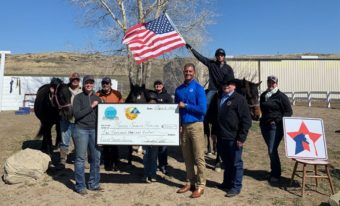 people from Horses Spirits Healing with a check