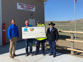 Fuego Volunteer Fire Department holding check from YVEC
