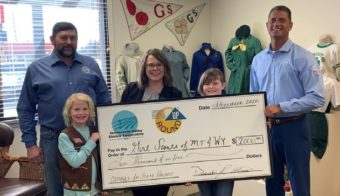 Girl Scouts of Montana and Wyoming holding check from operation round up program